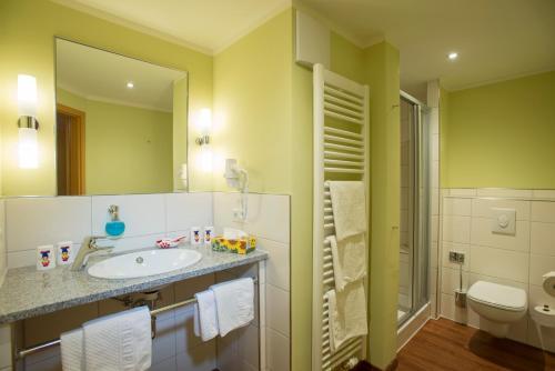 Ein Badezimmer in der Unterkunft Familotel Mein Krug