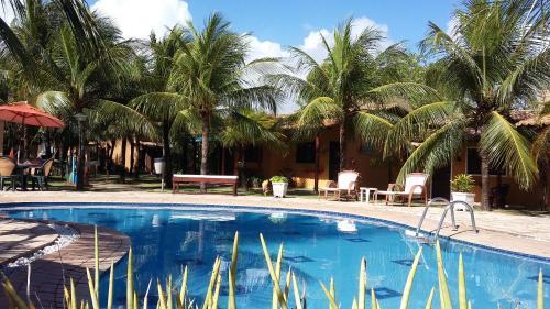 The swimming pool at or near Hotel Enseada Maracajaú