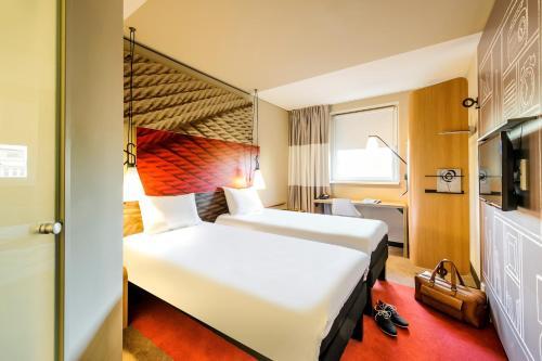 Кровать или кровати в номере ibis Hotel Muenchen City West