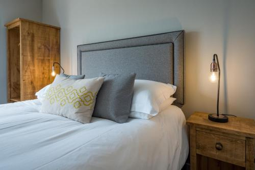 A bed or beds in a room at Cairngorm Guest House