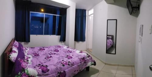A bed or beds in a room at Hostal El Griego