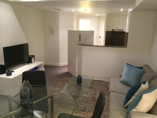 A television and/or entertainment center at Wyndel Apartments Sydney CBD - Bond