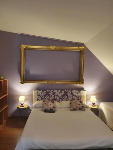 Letto o letti in una camera di Casa Aramis House & parcheggio gratis zona Navigli metro Porta Genova
