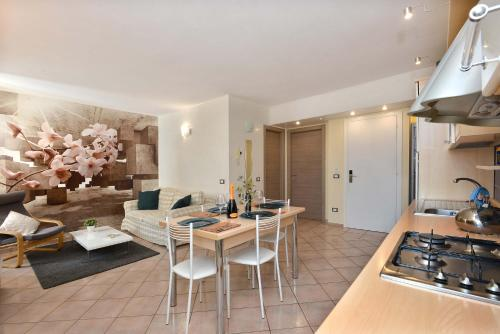 A kitchen or kitchenette at Antiche Rive Holidays Apartments