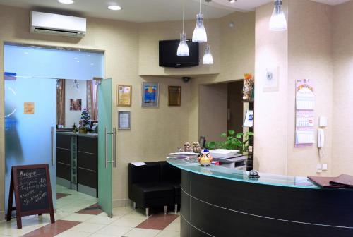 Лобби или стойка регистрации в Отель 9 Сов