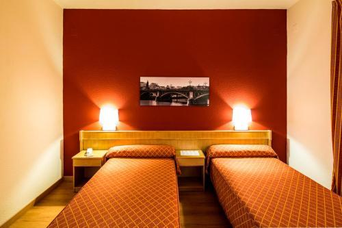 Кровать или кровати в номере TRH La Motilla