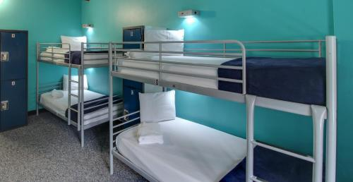 A bunk bed or bunk beds in a room at HI NYC Hostel