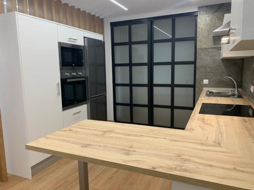 Una cocina o zona de cocina en Oktheway Pedro Saco Street