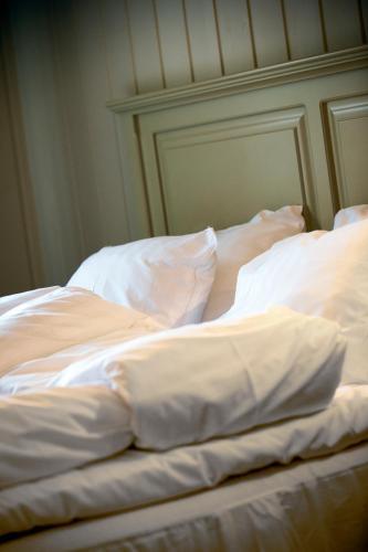 Säng eller sängar i ett rum på Krokstad Herrgård