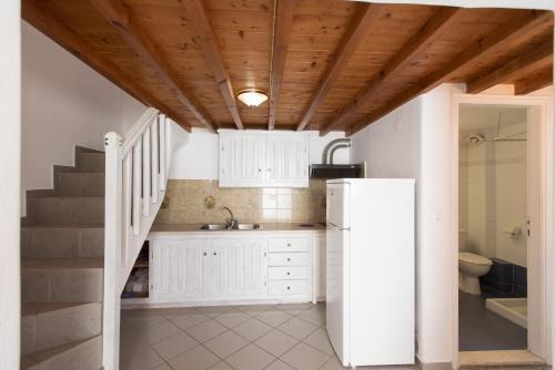Η κουζίνα ή μικρή κουζίνα στο Madres Houses