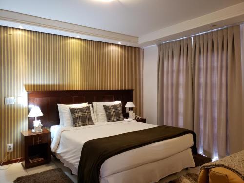 A bed or beds in a room at Pousada Cheverny - Seguindo as normas do Ministerio da Saude