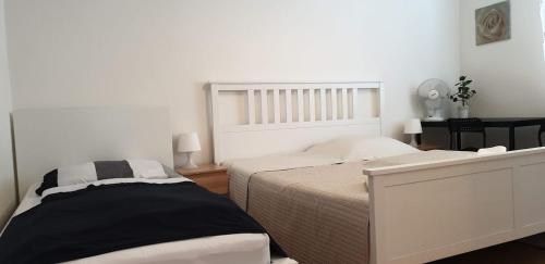 A bed or beds in a room at Penzion Sofi