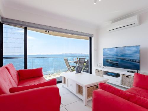 A seating area at 2 'Lanimer' 14 Mitchell Street - beautiful waterfront property with spectacular views