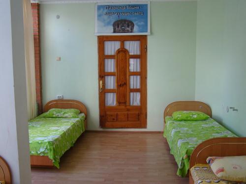 Кровать или кровати в номере Adore