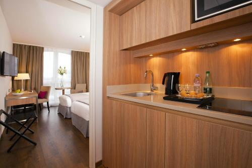 A kitchen or kitchenette at Residhome Roissy Park