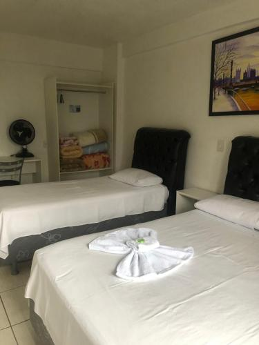 A bed or beds in a room at Hotel Iguaçu