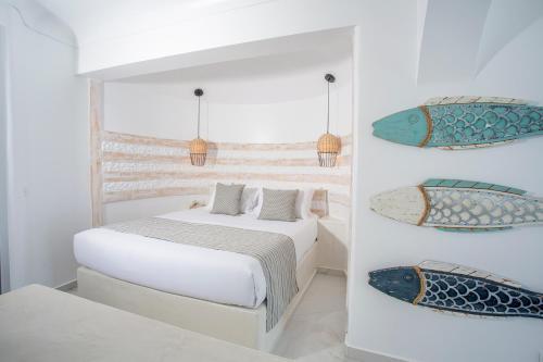Ένα ή περισσότερα κρεβάτια σε δωμάτιο στο Rhodos Horizon Blu