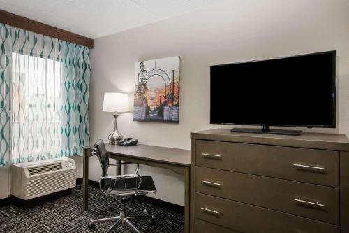 A television and/or entertainment center at La Quinta Inn by Wyndham Davenport & Conference Center