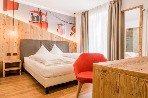 Letto o letti in una camera di Hotel Astoria