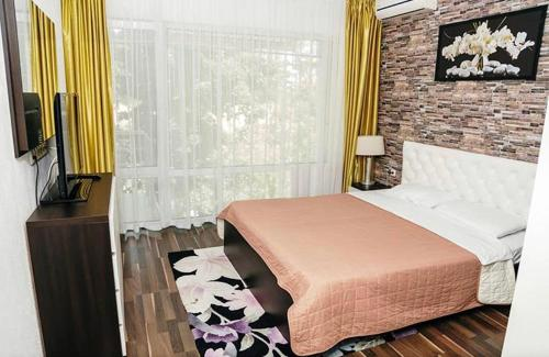 Кровать или кровати в номере Apartments Georg-Grad