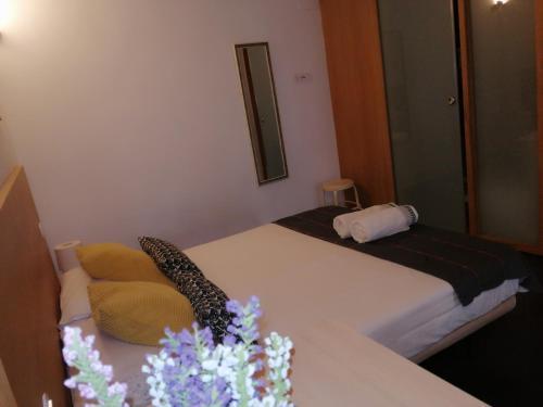Cama o camas de una habitación en Apartamentos 14DeSande