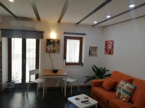 Zona de estar de Apartamentos 14DeSande