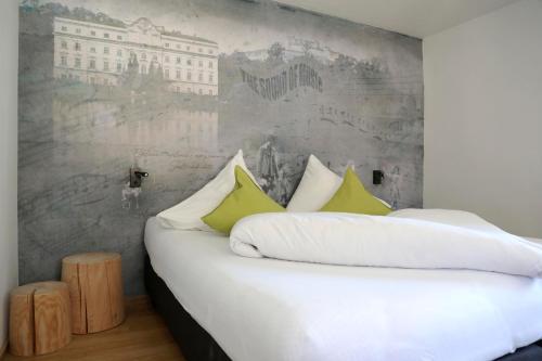 Ein Bett oder Betten in einem Zimmer der Unterkunft Apartments Ante Portas