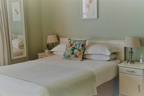 A bed or beds in a room at The Greenhouse Guesthouse