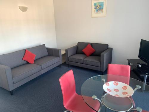 A seating area at Aquarius Apartments Mollymook