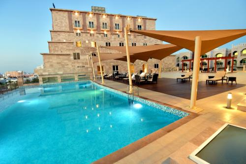 The swimming pool at or close to Somerset Panorama Muscat