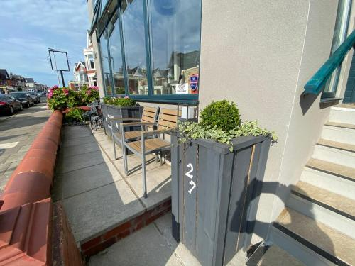 A balcony or terrace at The Mayfield Boutique Guest House