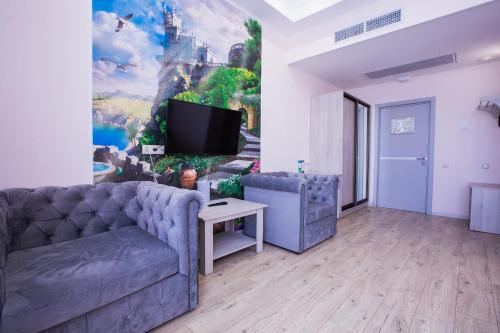 A television and/or entertainment center at Portofino Hotel