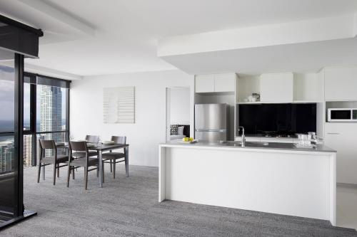 A kitchen or kitchenette at Mantra Circle On Cavill