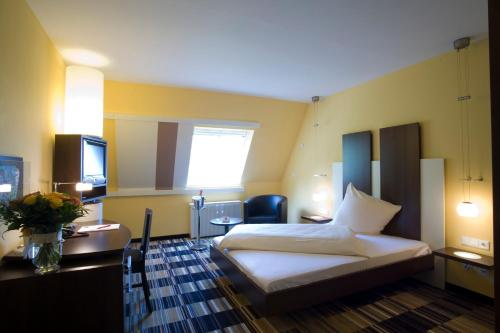 Ein Bett oder Betten in einem Zimmer der Unterkunft Hotel Kattenbusch