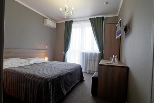 A bed or beds in a room at Мини-отель Маленький принц