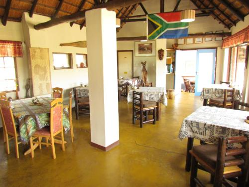 A restaurant or other place to eat at Thokozani Lodge