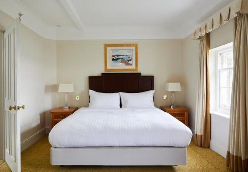 A bed or beds in a room at Bournemouth Highcliff Marriott Hotel