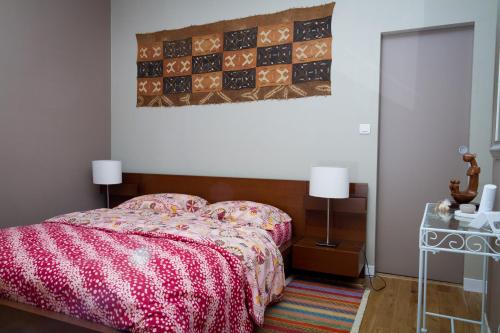 A bed or beds in a room at Appartement Rennel