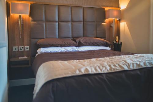 A bed or beds in a room at The Fort Hotel