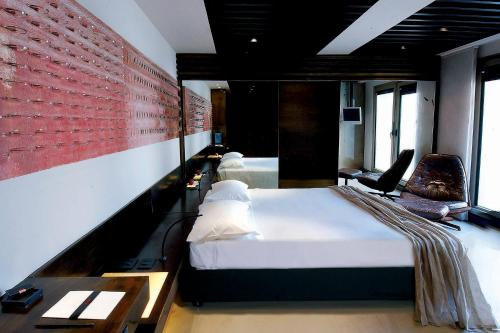 A bed or beds in a room at STRAF | a Member of Design Hotels™