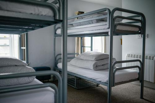 A bunk bed or bunk beds in a room at The Woodquay Hostel