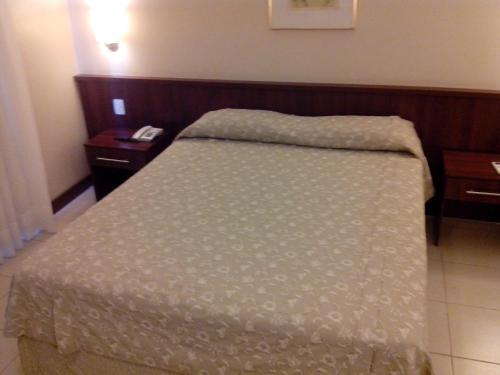 A bed or beds in a room at Aracoara Hotel