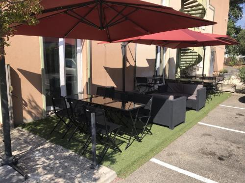 A porch or other outdoor area at Face West Le Pontet