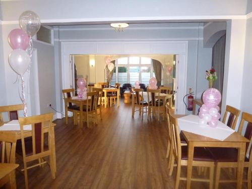 A restaurant or other place to eat at Orrell Park Hotel