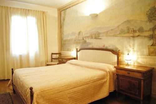Cama o camas de una habitación en Melarancio Apartments