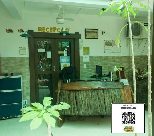 The lobby or reception area at Pousada Coqueiro do Caitá