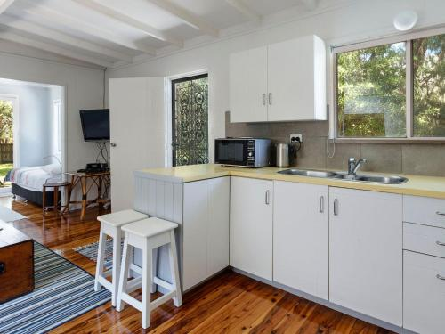 A kitchen or kitchenette at Enjoy the soothing sea breeze