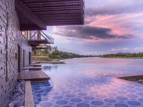 The swimming pool at or close to X2 River Kwai Resort