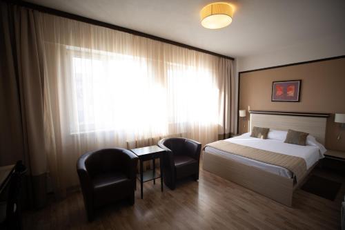 A room at Hotel Check Inn