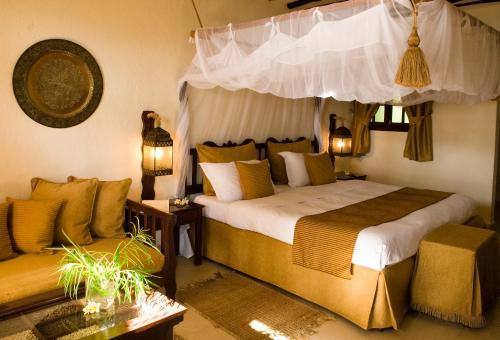 Кровать или кровати в номере Breezes Beach Club and Spa